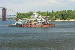 Floating crane towed along the river Dnieper Stock Photos
