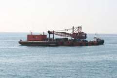 Floating crane and tugboat Stock Image