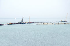 Floating cranes on the construction of the bridge Kerch Royalty Free Stock Photography
