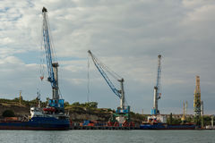 Floating cranes lift trucks in the Bay of Black Sea. Royalty Free Stock Photos