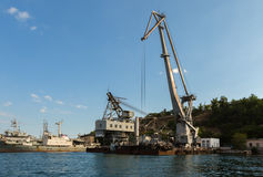 Floating cranes lift trucks in the Bay of Black Sea. Stock Images