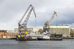 Floating cranes and tugs on the river Neva in Saint Petersburg Stock Photo