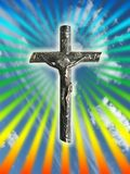 Floating cross. In the sky with rainbow rays of light Royalty Free Stock Photos