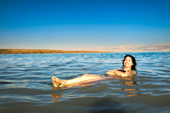 Floating on the Dead Sea Royalty Free Stock Images