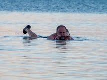 Floating on the Dead Sea, Israel