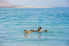 Floating in the dead sea Royalty Free Stock Photos