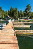 Floating dock on the Diamond Lake (OR). Some boats floating in the Diamond Lake royalty free stock image