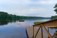 Floating dock and floats on lake Stock Photography