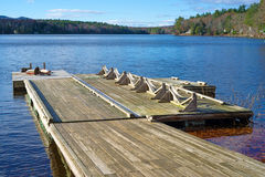 Floating dock leading to a small lake Royalty Free Stock Photos