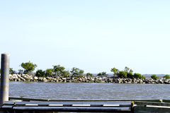 Floating Dock by Rock Breakwater Royalty Free Stock Photo