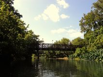 Floating down the river. Bridge over San Marcos River in San Marcos, Texas royalty free stock photography