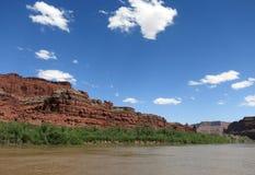 Floating downriver in desert landscape. Floating down Colorado River on jetboat tour through red rock cliff landscape near Moab, Utah Stock Image