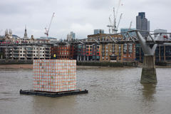Floating Dreams lantern in London. LONDON, UK - CIRCA SEPTEMBER 2016: Floating Dreams by Ik Joong Kang is a cube lantern lit from inside, floating on the river Stock Photo