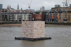 Floating Dreams lantern in London. LONDON, UK - CIRCA SEPTEMBER 2016: Floating Dreams by Ik Joong Kang is a cube lantern lit from inside, floating on the river Royalty Free Stock Images