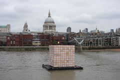 Floating Dreams lantern in London. LONDON, UK - CIRCA SEPTEMBER 2016: Floating Dreams by Ik Joong Kang is a cube lantern lit from inside, floating on the river Stock Images