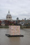 Floating Dreams lantern in London. LONDON, UK - CIRCA SEPTEMBER 2016: Floating Dreams by Ik Joong Kang is a cube lantern lit from inside, floating on the river Royalty Free Stock Image