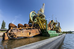 The floating dredge on the river Stock Images