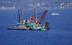 Floating dredging platform in Bosphorus Stock Image