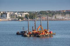 Floating dredging platform on the sea Stock Photos