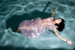 Floating in dress Royalty Free Stock Photo