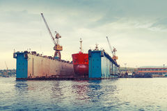 Floating dry dock with red tanker under repair Royalty Free Stock Image