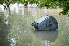 Floating dumpster in flood Royalty Free Stock Photo