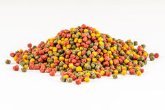 Floating extruded fish feed Royalty Free Stock Photo
