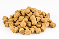 Floating extruded fish feed Royalty Free Stock Image