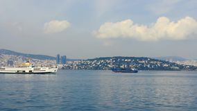 Floating ferry and boat on the sea. The city looks stock footage
