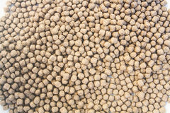 Floating Fish Feed Pellet Royalty Free Stock Photography