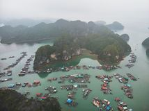 Floating fisherman\'s village in ha long bay, northern vietnam. top view, aerial view. A floating fisherman\'s village in ha long bay, northern vietnam. top view royalty free stock photography