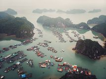 Floating fisherman\'s village in ha long bay, northern vietnam. top view, aerial view. A floating fisherman\'s village in ha long bay, northern vietnam. top view stock photography