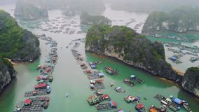 Floating fisherman`s village in ha long bay, northern vietnam. top view, aerial view stock video