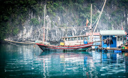 Floating fishing boat. Halong Bay, Vietnam. Royalty Free Stock Photography