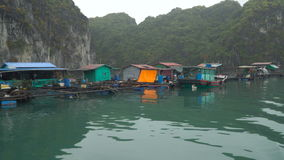 Floating fishing village. Boat trip. Floating fishing village and rock islands in Halong Bay, Vietnam, Southeast Asia. 4K stock video