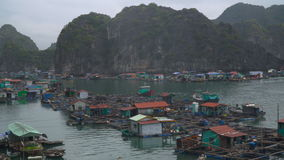 Floating fishing village. And rock islands in Halong Bay, Vietnam, Southeast Asia. The movement of ships in the Gulf stock footage