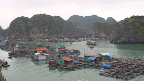 Floating fishing village. And rock islands in Halong Bay, Vietnam, Southeast Asia. The movement of ships in the Gulf. Timelapse stock video