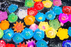 Floating flower candles by various colors royalty free stock photography