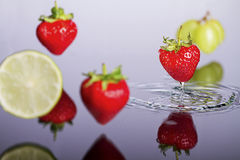 Floating fruits above the water surface. Floating fruits above the water surface, strawberries Stock Photo