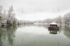 Floating gazebo in the lake in the winter. Floating gazebo in the middle of the lake in winter with the cable car Stock Image