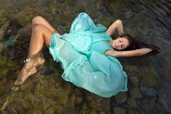Floating girl in green dress Royalty Free Stock Photos