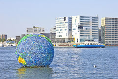 Floating globe art on the water, Amsterdam Royalty Free Stock Images