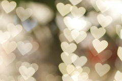 Floating gold heart shape bokeh. Gold heart shape bokeh background Royalty Free Stock Photography