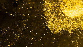 Floating gold nuggets and black dust particles on a nebulous background stock footage