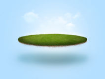 Floating Golf Green. A golf green floating in the air on blue background Stock Images