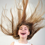 Floating hair. Beautiful happy smiling girl with long hair Royalty Free Stock Photos