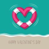 Floating heart shaped life buoy Stock Photos