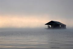 Floating home in the morning fog. Stock Photo