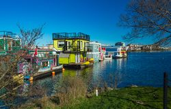 Floating Home Village colorful Houseboats Water Taxi Fisherman`s Wharf Reflection Inner Harbor, Victoria British Columbia Canada. Pacific Northwest. Area has stock photography