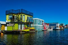 Floating Home Village colorful Houseboats Water Taxi Fisherman`s Wharf Reflection Inner Harbor, Victoria British Columbia Canada. Pacific Northwest. Area has royalty free stock photography